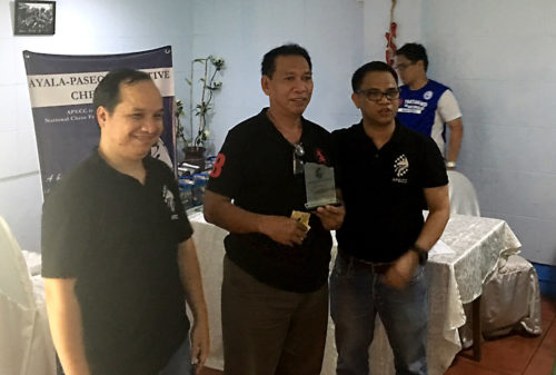 June 2016 APECC Executive Chess Tournament 3rd place finisher Edgar Bautista with the officers of APECC, Val De Guzman and Roland Roselada (President).