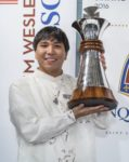 Wesley So, the champion of the Sinquefield Cup 2016 holds out his trophy.